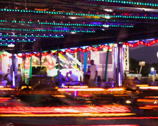 Motion dodgems attraction with colorful lamps