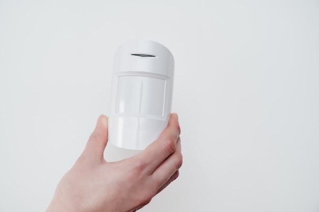 Motion sensor in hand on white background.