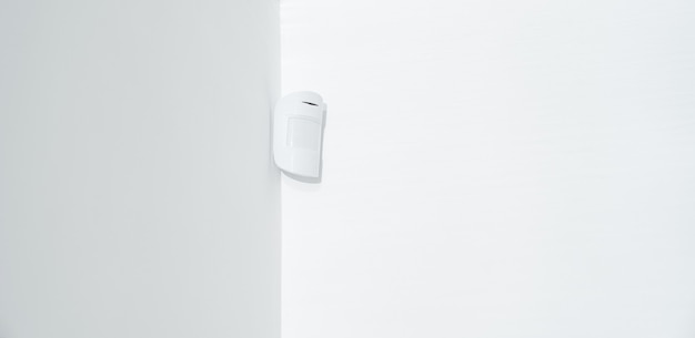 Motion sensor oin the white corner. device that tracks the movement of objects.