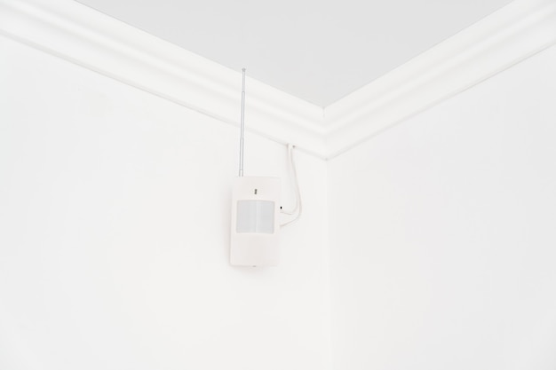 The motion sensor on the white wall