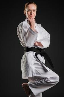 Motivated karate fighter posing medium shot
