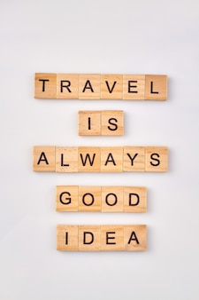 Motivation quote for travel. travel is always good idea. journey concept written with wooden blocks on white background.