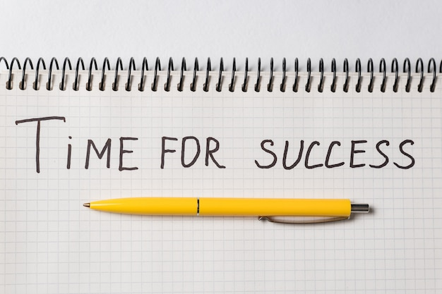 Motivational inscription time to success. notebook and pen. close up