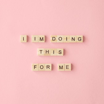 Motivational text on pink background