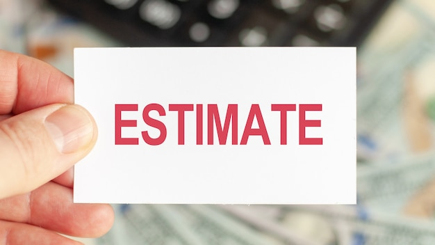 Motivational words: corporate bonds. man holds a piece of paper with the text: estimate.