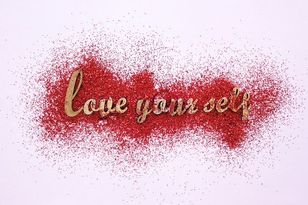 Motivational writing on red glitter