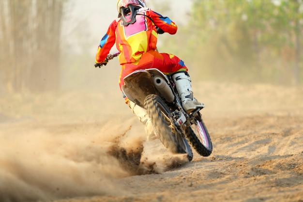 Motocross racer accelerating speed in track