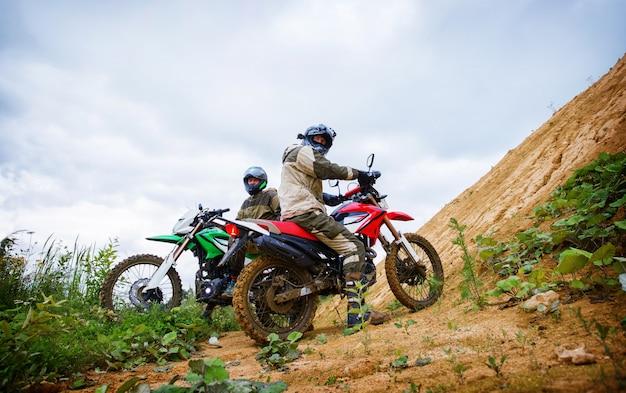 Motocross racers on landscape