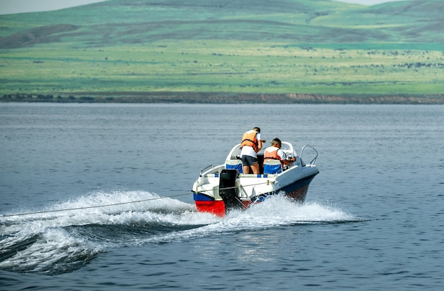 Motor boat with rescuers rushes through the sea waves