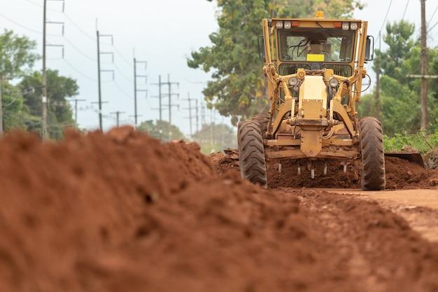 Motor grader civil construction improvement base road work.
