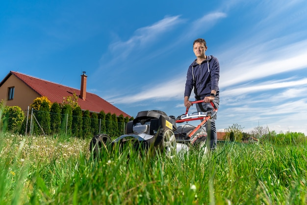 Motor mower to mow the lawn next to the family house