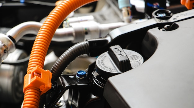 Motor oil cap or engine oil under the hood of a car. maintenance car or repair automotive concept