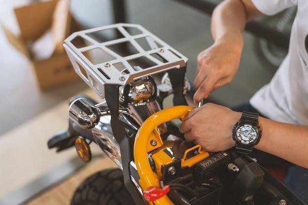 Motor style. mechanic fixing motorcycle