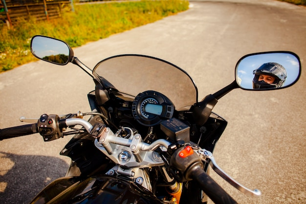 Motorbike grips with rearview mirrors view of the biker
