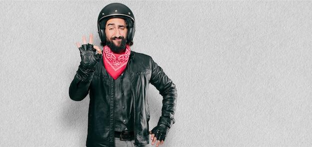Motorbike rider alright gesture