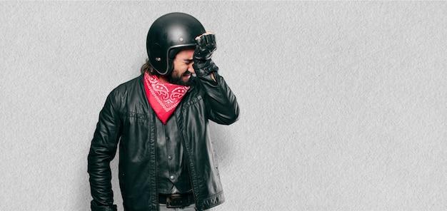 Motorbike rider crying sad
