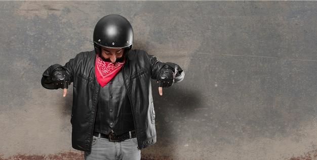 Motorbike rider pointing sign
