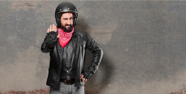 Motorbike rider stop sign
