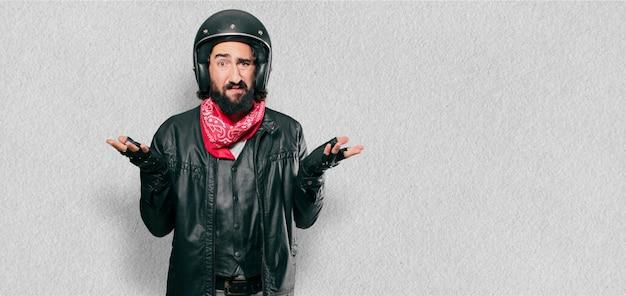 Motorbike rider thinking or doubting