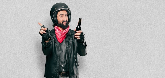 Motorbike rider with a beer bottle