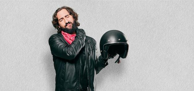 Motorbike rider with a helmet.