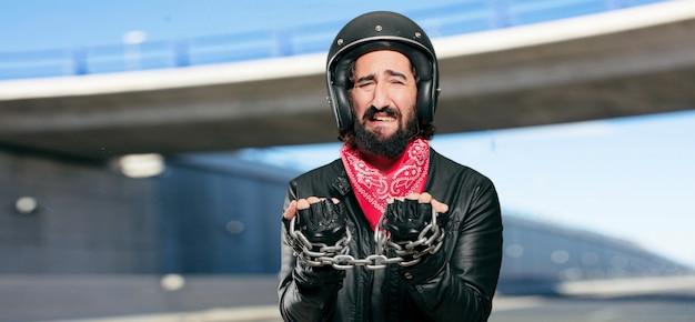 Motorbike rider with a steel chain