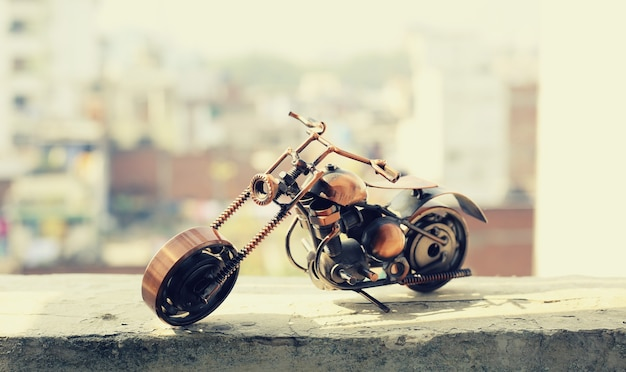 Motorbike on the wall with blur background. vintage custom motorcycle toy.
