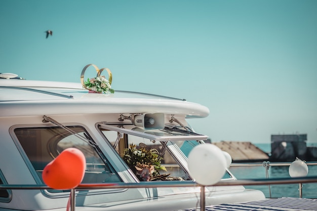 Motorboat, yacht decorated with flowers and balloons for wedding