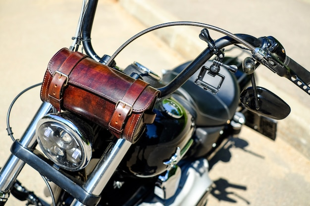 Motorcycle choppermotorcycle chopper with leather handbag on the steering wheel