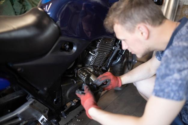 Motorcycle engine repair in the garage diagnostics