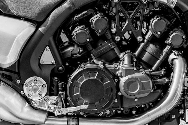 Motorcycle gasoline engine. modern vehicle. a shiny metal device.