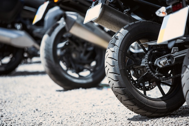 Motorcycle luxury items close-up: headlights, shock absorber, wheel, wing, toning.