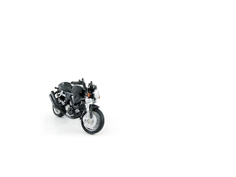 Motorcycle toy black colour on white background