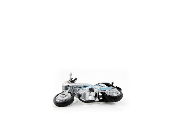 Motorcycle toy gray colour accident failed on white background
