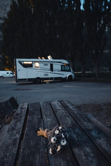 Motorhome camper vehicle for transport and vacation leisure people parked near a forest woods enjoying outdoors in travel lifestyle