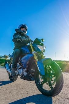 Motorist on blue motorbike
