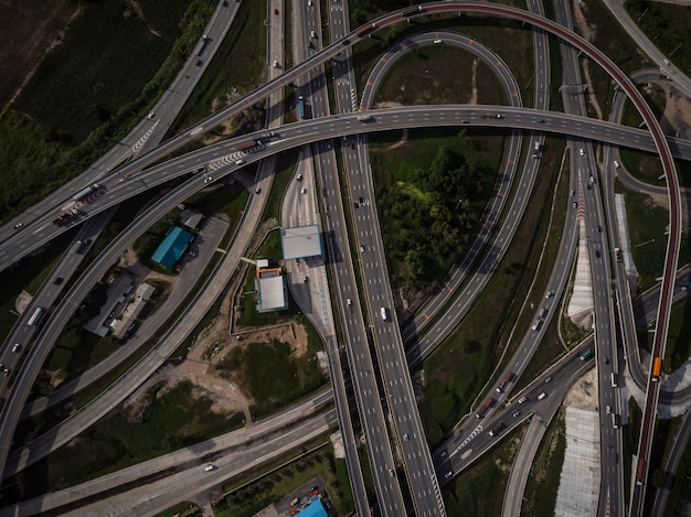 Motorway highway and expressway with the ring industry top eye view frome drone