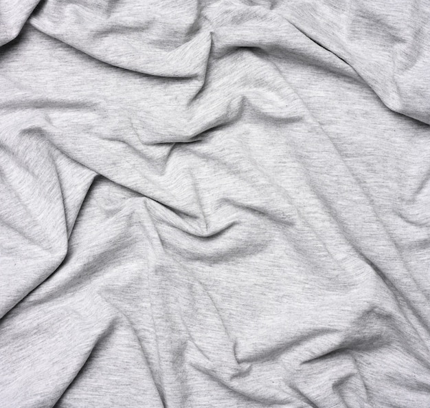 Mottled gray cotton fabric for clothing, fabric creased, close up