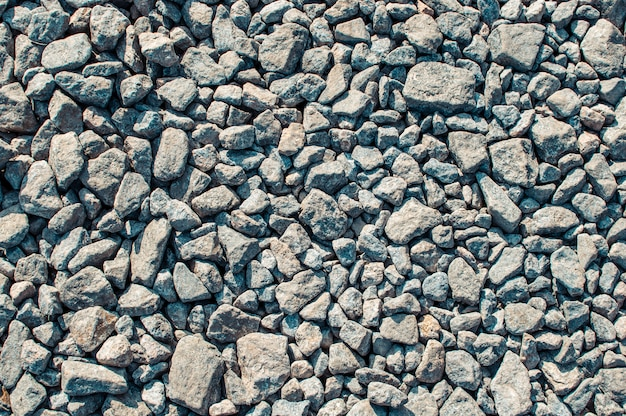 Mound of granite gravel, stones, crushed stone close-up.