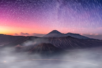 Mount active volcano, Batok, Bromo, Semeru with starry and fog at dawn