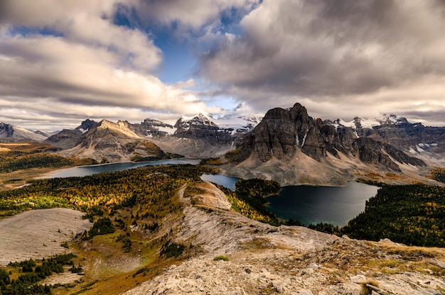 Mount assiniboine with lake on nublet peak in autumn forest on sunset at provincial park