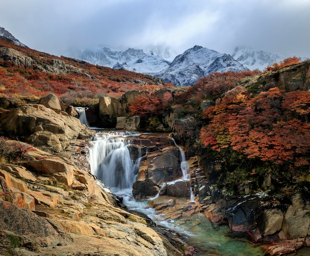 The mount fitz roy and the waterfall at dawn. los glaciares national park, andes, patagonia, argentina