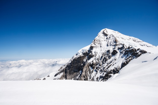 Mount jungfrau with cloud and blue sky background, switzerland
