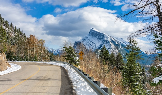 Mount rundle snowy forest mountain road banff national park in winter canadian rockies canada