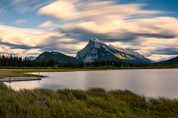 Mount rundle in vermillion lake with wooden pier on sunset at banff national park
