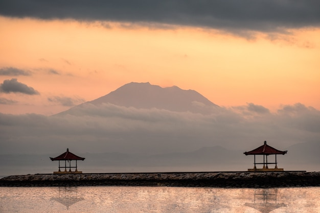Mount volcano (agung) with two pavilion on jetty