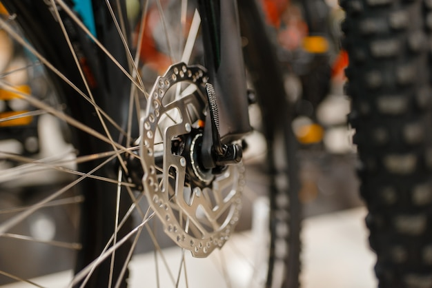Mountain bicycle in sports shop, focus on disc brake
