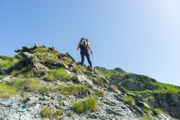 Mountain climbing on steep rocky slope