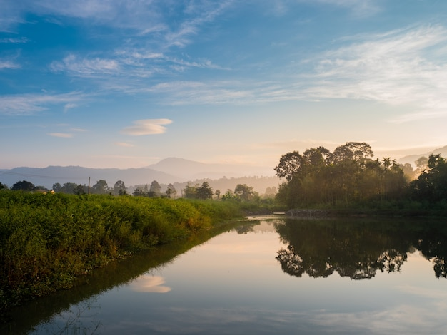 Mountain forest nature and reflectation on river with blue sky sunrise in the moning.