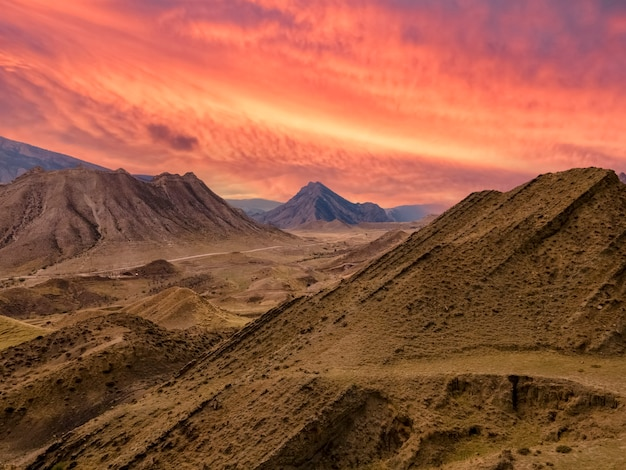 Mountain landscape against the backdrop of a fiery red sunset